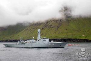 The Danish Navy vessel, HDMS Triton attempts to block the view of the arrest of the Sea Shepherd crew from the Sam Simon.