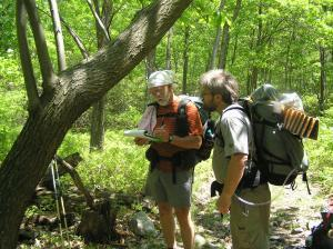 "Hikers on the Applachian Trail near Sunfish Pont in New Jersey. They are cataloguing a ""big"" tree (>4"" dbh) while doing counts of smaller trees per AT section"