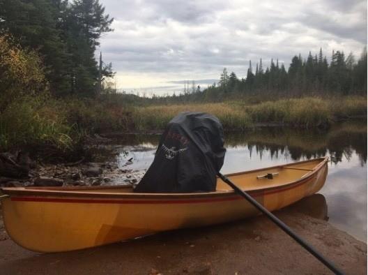 Vehicles of choice, Hornbeck solo canoe and Osprey backpack, await descent of Oswegatchie River, northwest Adirondack Park