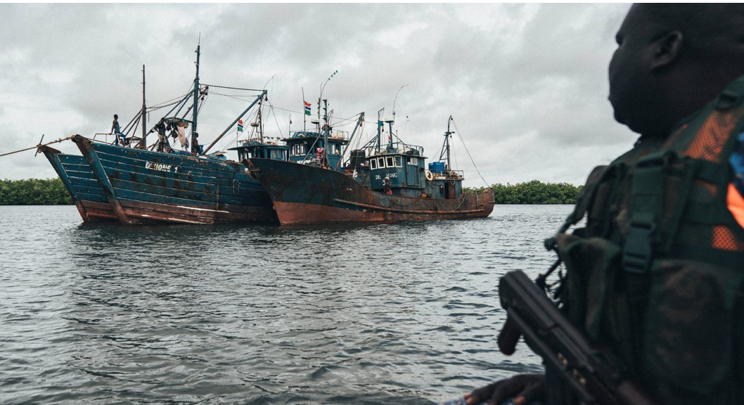 A Gambian navy sailor watches over three trawlers arrested during Sea Shepherd's operation to prevent illegal fishing off the West African country's coast (Image © Leon Greiner / Sea Shepherd)