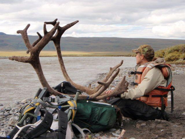 Holly Endersby on the banks of the Atigun during Arctic hunting trip.