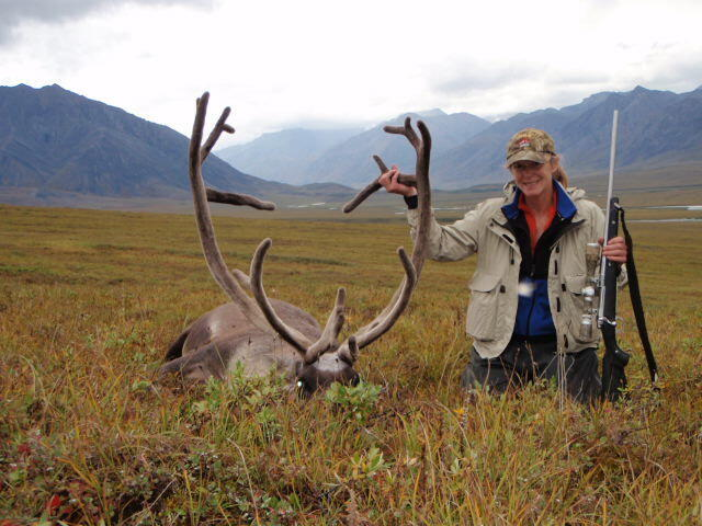 Holly Endersby with caribou on Arctic hunting trip.