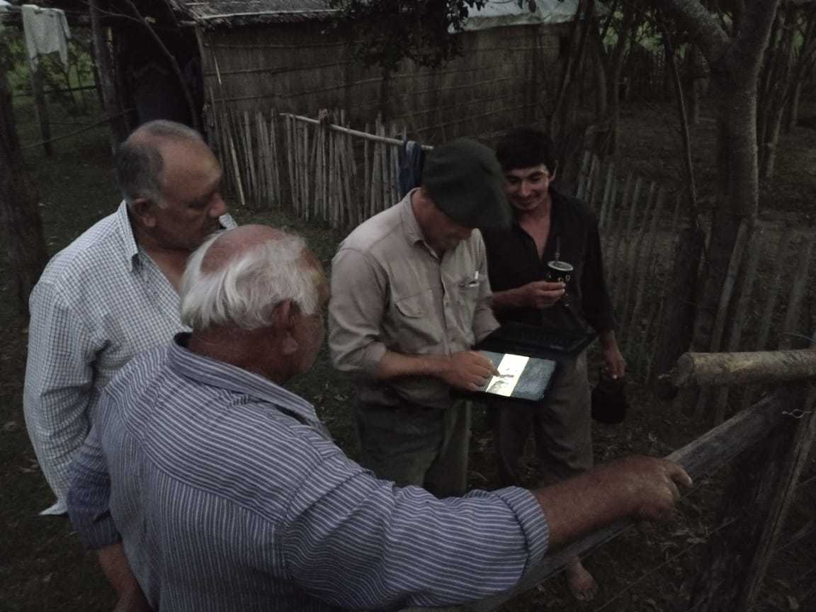 Juan showing videos of the jaguars to local people